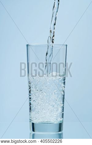 Pouring Water. Pouring Fresh Clean Drinking Water To Glass.