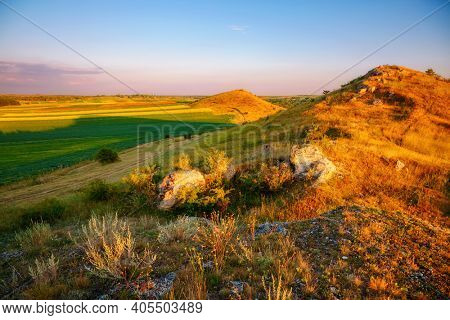 Splendid summer scene of a rolling hills on a sunny day. Location place Dniester canyon of Ukraine, Europe. Image of world landmarks. Picturesque photo wallpaper. Discover the beauty of earth.