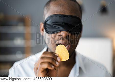 Blindfold Food Taste. African Men Blindfolded Tasting