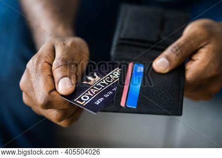 Loyalty Reward Points Program Card In Hand
