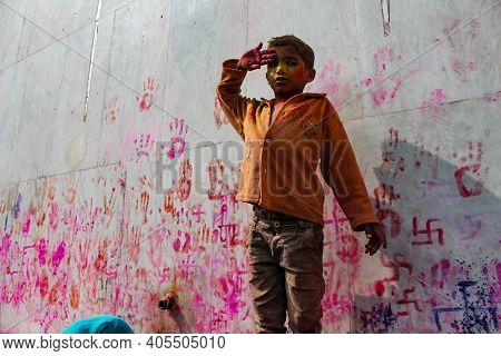 Mathura, Uttar Pradesh, India- January 28 2020: Potrait Of A Young Kid Covered Fully In Colors Of Ho