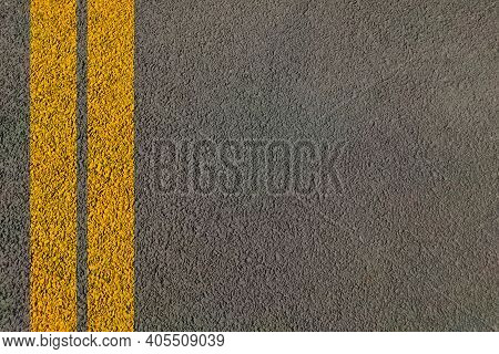 Road Dividing Yellow Lines On Asphalt Highway Background Painted For Transport Traffic Control And G
