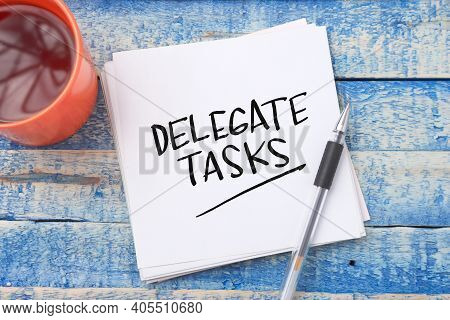 Delegate Tasks, Text Words Typography Written On Book Against Wooden Background, Life And Business M
