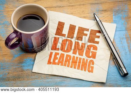 lifelong learning concept -  word abstract on a napkin with a cup of espresso coffee, education, lifestyle and personal development
