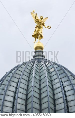 Dresden, Germany - September 23, 2020 : The Glass Dome With Golden Statue Of Pheme Of Dresden Academ