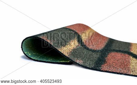 Dark Green, Yellow, And Orange Shingle Roof On White Background. Roofing Material. Shingle Roof Text