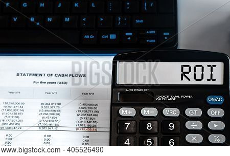 Calculator With The Word Roi - Return On Investment On The Display. Money, Finance And Business Conc