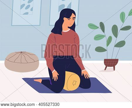 Peaceful Young Woman Meditating In Kneeling Yoga Position With Cushion. Relaxed Female Character Pra