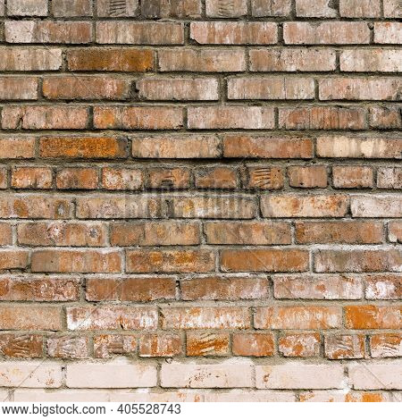 Vintage Red Brick Wall Background. Aged Wall Texture. Distressed Brickwork. Grungy Stonewall Backgro