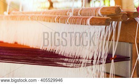 Closeup View Thread Of Ancient Weaving Loom.