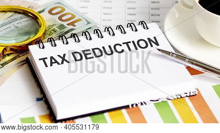 Tax Deduction .top View Office Table, Business Graph Show For Marketing Plan Have Book, Pen, Black C