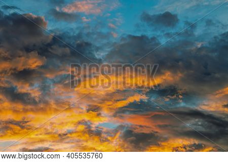 Colorful With Yellow, Orange And Blue In The Evening In Autumn. A Dramatic Sky Includes A Cloud, Sun