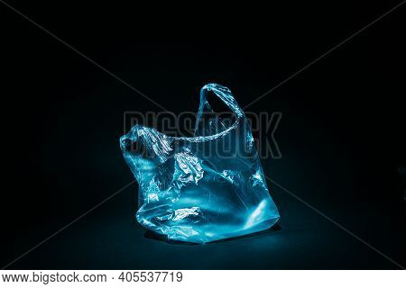 Plastic Pollution. Waste Contamination. Ecology Problem. Blue Empty Used Cellophane Bag Floating Und