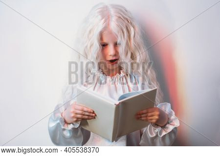 Kid Curiosity. Amazing Discovery. Kids Literature. Portrait Of Surprised Sweet Blonde Small Girl In