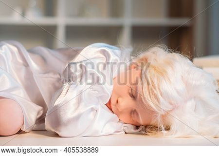 Child Nap. Kid Innocence. Rest Tranquility. Calm Tired Cute Blonde Albino Small Girl In White Silk N