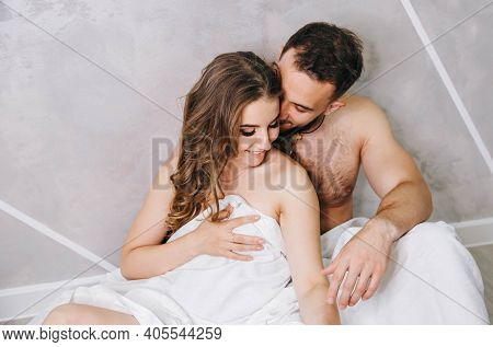 Lovers Relaxing In Cozy Bedroom, Enjoy Intimacy After Love Making. Lovers Make Love Under The Blanke