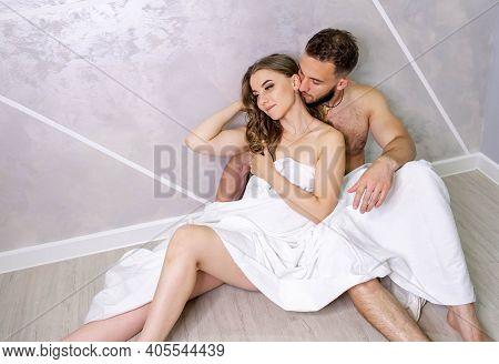 Boyfriend And Girlfriend Naked Under Duvet After Having Sex. Lovers Relaxing In Cozy Bedroom, Enjoy
