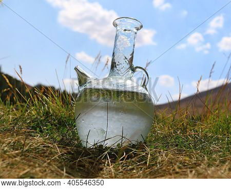 A Traditional Lebanese Water Jug, Ebreek, Filled With Cold Water In Grass.