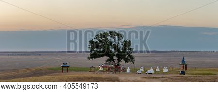 The Sacred Tree In Kalmykia. Silhouette Of A Gate Or Arch At The Entrance To The Cult Object.