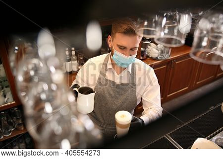 Barista Preparing Coffee At Counter In Restaurant. Catering During Coronavirus Quarantine