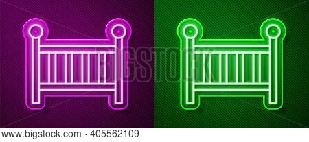 Glowing Neon Line Baby Crib Cradle Bed Icon Isolated On Purple And Green Background. Vector