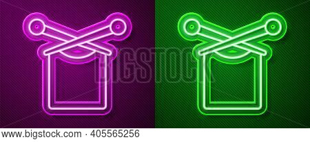 Glowing Neon Line Knitting Icon Isolated On Purple And Green Background. Wool Emblem With Knitted Fa