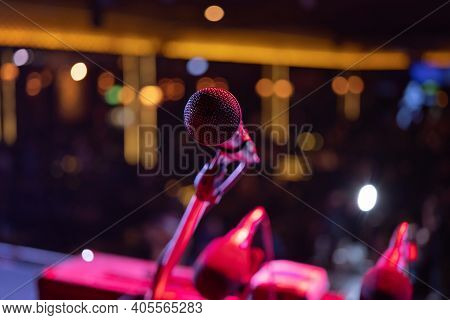 A Microphone On Stage Concert With Colorful Lighting Laser Beam Spotlight Show In Disco Pub Club Bar