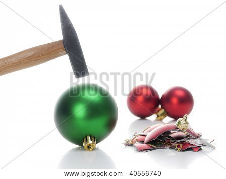 Hammer hitting christmas ball breaking it into pieces - concept depicting aversion to celebrate christmas holidays poster