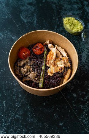 Healthy Food Bowl With Chicken, Black Rice Or Wild Rice, Mushroom, Avocado Mash And Roasted Grilled