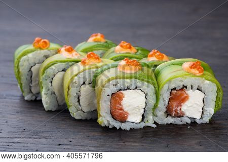 Traditional Japanese Sushi With Salmon, Avocado And Soft Cheese, Garnished With Red Caviar. Japanese