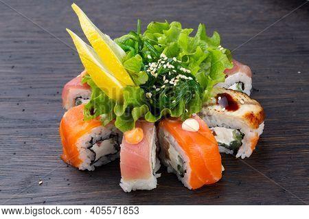 Set Nigiri Sushi Set With Tuna, Salmon, Prawns, Sea Bass. Sushi Nigiri Collection On Black Backgroun