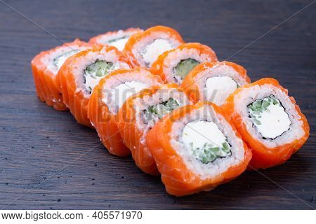 Traditional Baked Japanese Sushi With Salmon, Avocado And Soft Cheese, Garnished With Sauce. Japanes