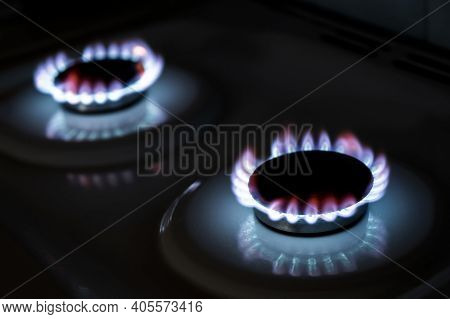 Burning Gas Burner In The Darkness. The Flame Of A Burning Gas Fire On A Black Background.