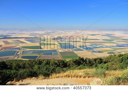 Picturesque squares colored fields of the valley of Galilee. Photographed from Mount Barkan