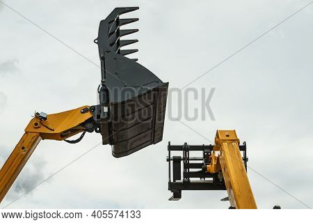 Industrial Hay Telehandler Against Sky. Telescopic Handler. Agricultural Machinery, Farm Equipment.