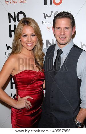 LOS ANGELES - DEC 12:  Jessica Hall, Kyle Carlson arrive to the NOH8 4th Anniversary Party at Avalon on December 12, 2012 in Los Angeles, CA
