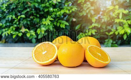 Close-up Of Front Orange Fruit On The Table With Green Background At Sunrise, Selective Focus On Fre
