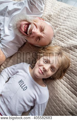 Man Staying In A Bed With His Grandson