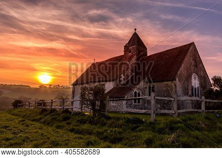 Sunset At The Isolated St Hubert's Church In Idsworth, South Downs National Park, Uk Uk With A Drama