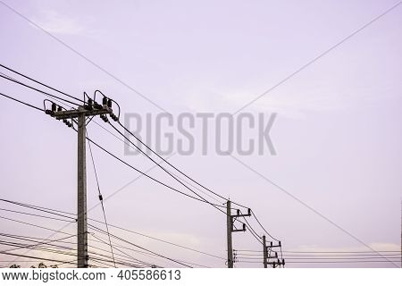 Electricity Pole With Dark Sky Before Sunrise, Transmission Line Of Electricity To Rural, Electricit
