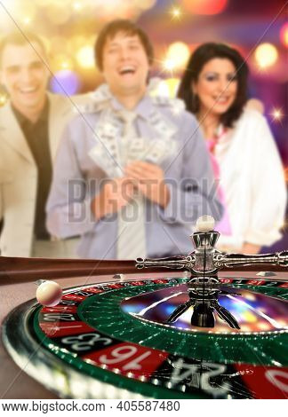 Friends playing roulette at the casino - Shallow depth of field