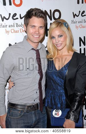 LOS ANGELES - DEC 12:  Drew Seeley, Amy Paffrath arrive to the NOH8 4th Anniversary Party at Avalon on December 12, 2012 in Los Angeles, CA