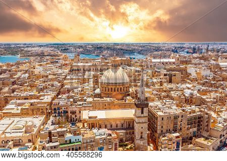Aerial View Early Morning At Sunrise Of Lady Of Mount Carmel Church, St.paul's Cathedral In Valletta