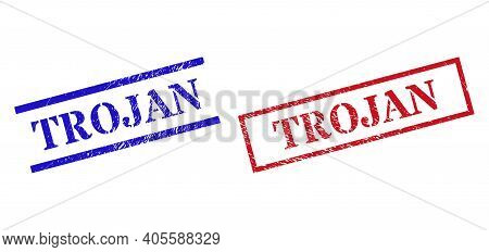 Grunge Trojan Rubber Stamps In Red And Blue Colors. Stamps Have Rubber Style. Vector Rubber Imitatio