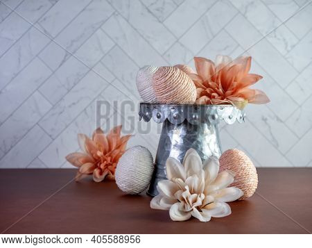 Peach And White String Decorated Easter Eggs On A Raised Metal Display With Peach Dahlia Flower Bloo