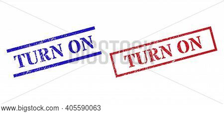 Grunge Turn On Rubber Stamps In Red And Blue Colors. Seals Have Rubber Texture. Vector Rubber Imitat