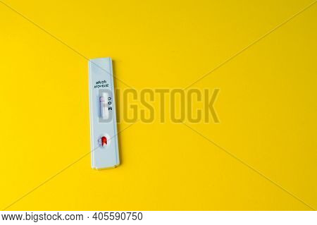 Test For Coronavirus Lies On A Yellow Background. Bright Picture. Testing For Coronavirus. Detection