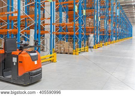 Electric Order Picker Truck In Distribution Warehouse