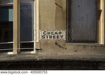 Cheap Steet Sign High On Building Wall