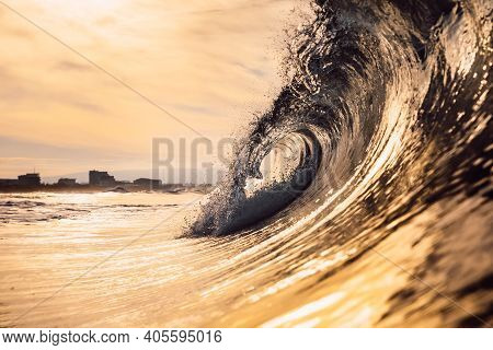 Glassy Wave At Sunrise. Breaking Ocean Wave With Warm Colors, Swell For Surfing